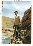 Jack Dallas in 1971 on rocks near beach at eastern end of the base.  Wire strung on far side of beach area marked Castro's Cuba.  While scuba diving from this beach I would sometimes stray o ...