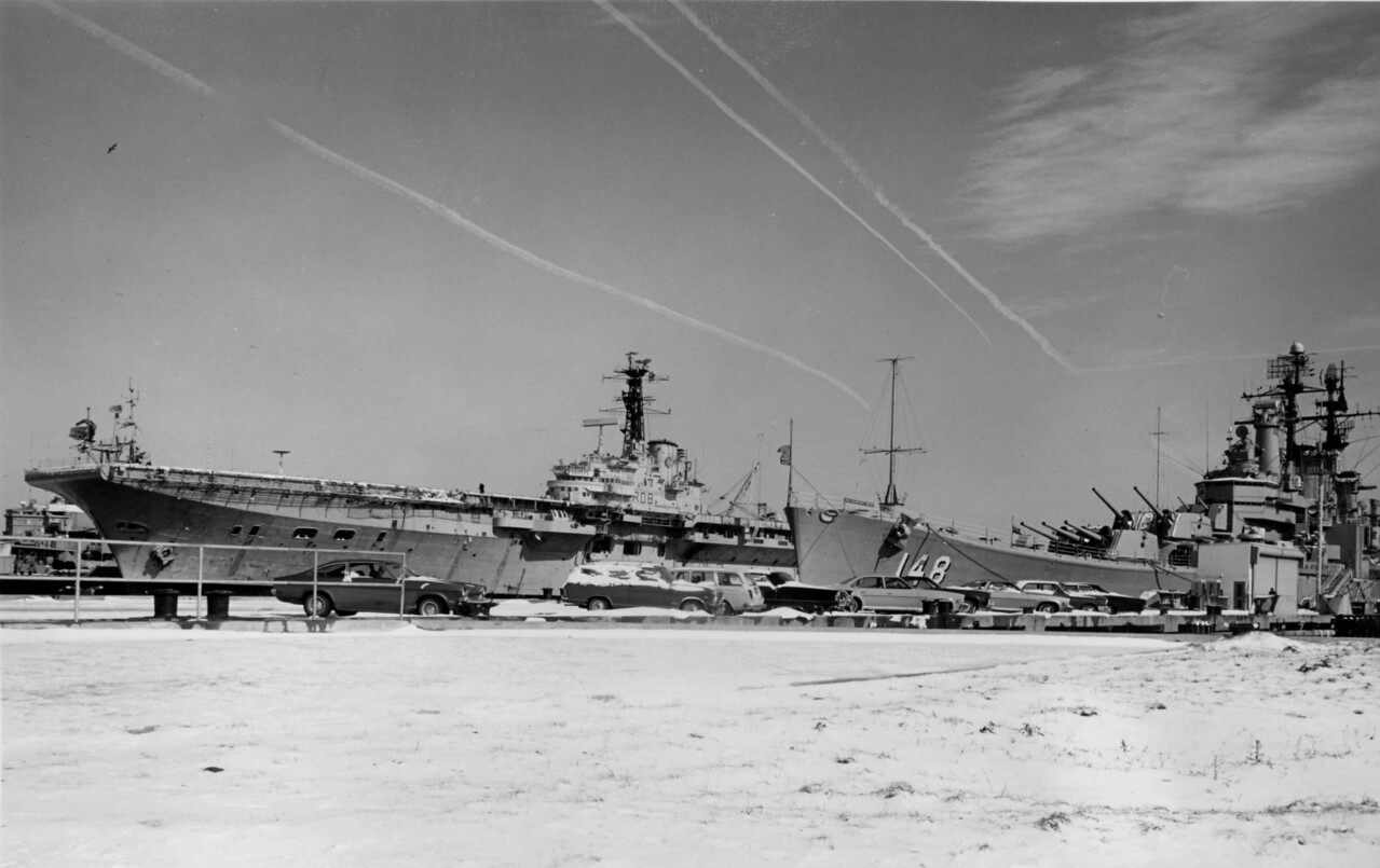 USS Newport News in the foreground.