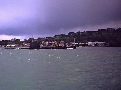 Submarine passes Mashfords boat yard. Taken from Caprice at Slip Jetty