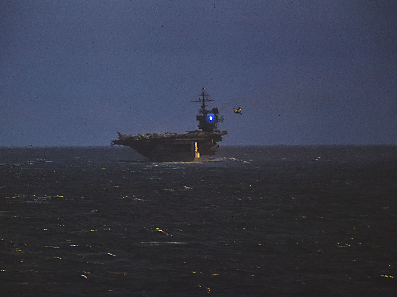 Helicopter from HMS Hermes photographs USS John F Kennedy.Oct 1973