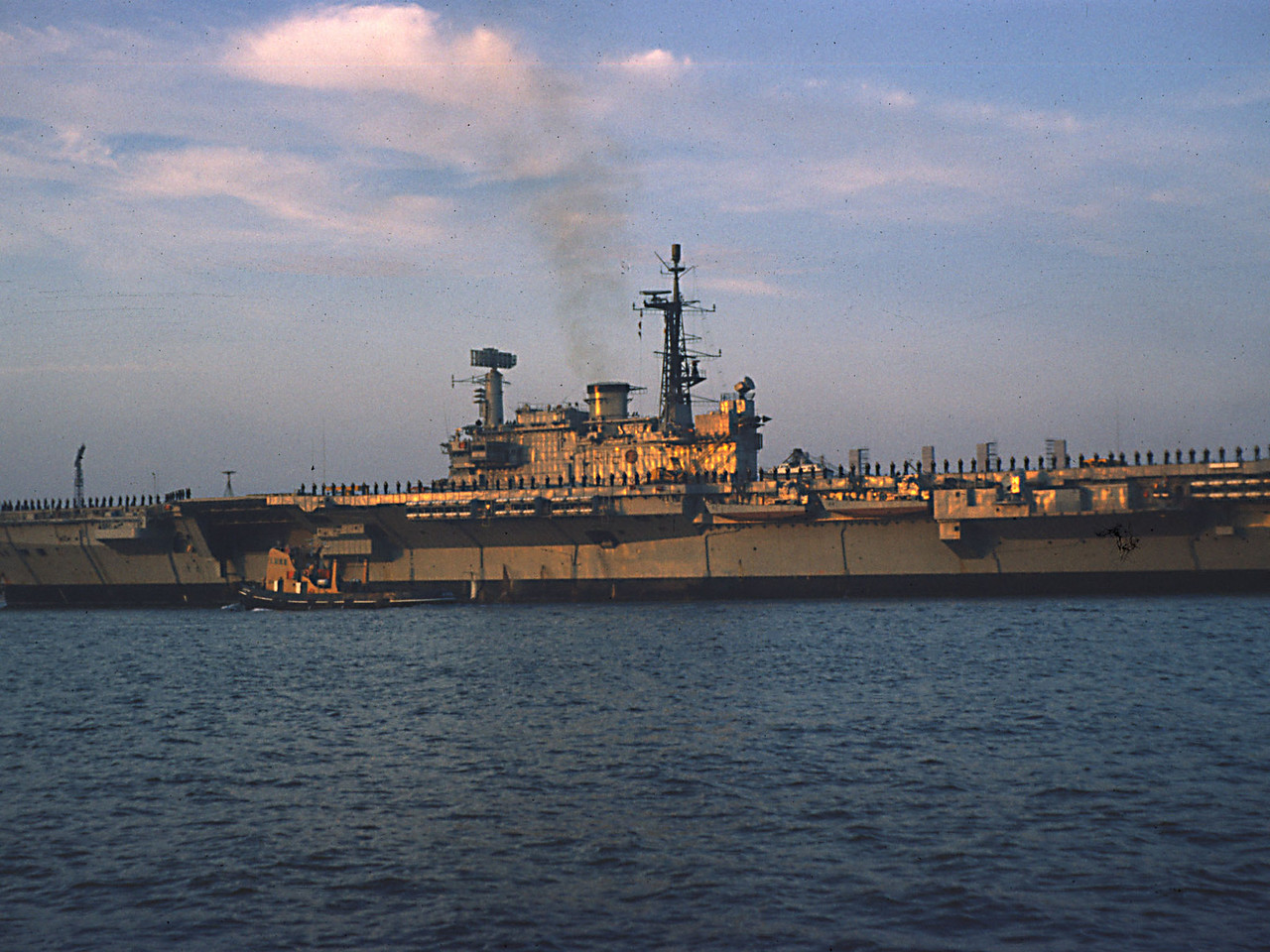 The evening sun reflects off Hermes. View from Torpoint. Aug 1974