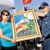 75 year old artist Ken Pridgeon presents a Gold Star mother with a painting of her son. Ken has painted half of all the Texas service members who have been killed in the Iraq and Afghanistan conflicts. He plans on painting one of every service member killed.
