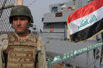 100213-N-0260R-001  Umm Qasar (Feb. 13, 2010) - An Iraqi Marine stands guard on the pier at Umm Qasar Iraqi Naval Base.  US Navy photo by Mass Communication Specialist 1st Class Brandon Raile.  (RELEASED)