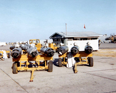 F-4 had no internal guns carry 50 cal on center line rack.  Trailer of gun pods waiting to be loaded.