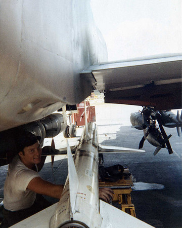 Mike guiding AIM-7 missile load, MK 82 on wing, CBU's centerline.
