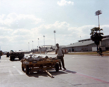 Melvin next to trailer with AIM 7 missiles.