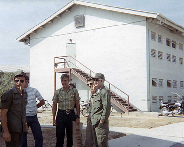 Outside the 408th MMS barracks (what a S@!T hole hat was).  Right to left, Phil Hooks, Larry Hardy, can't remember the others.