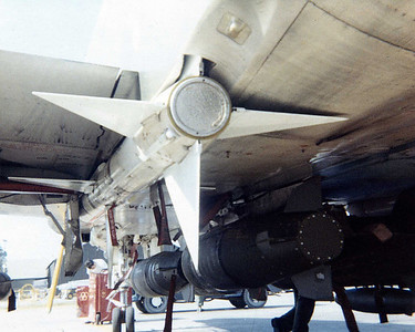 AIM-7 missile loaded with CBU's on centerline rack.