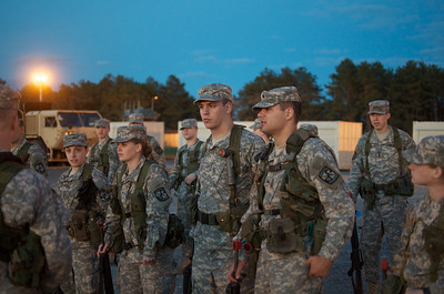 April 20, 2012, Camp Edwards, MA - ROTC cadets from multiple colleges in New England collect their weapons and gear after arriving at Tactical Training Base Kelley for a weekend Joint Field Training Exercise. Photo by Ryan Hutton