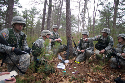 April 21, 2012 Camp Edwards, MA - ROTC cadets from multiple colleges in New England go over tactics during squad training exercises at Tactical Training Base Kelley during a weekend Joint Field Training Exercise. Photo by Ryan Hutton