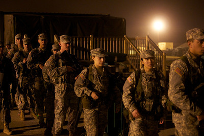 April 21, 2012, Camp Edwards, MA - ROTC cadets from multiple colleges in New England form line up for breakfast at 4:46 a.m. before a day of squad training exercises at Tactical Training Base Kelley during a weekend Joint Field Training Exercise. Photo by Ryan Hutton