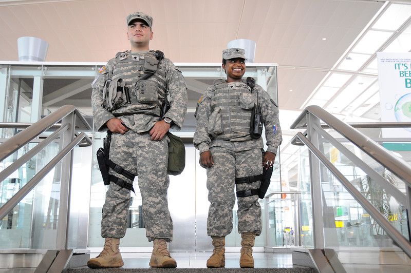 N.Y. National Guard service members assigned to Joint Task Force – Empire Shield alongside PAPD, DHS, TSA and other agencies provide security presence during a heightened security on the 9/11 anniversary on September 11, 2011 at JFK Airport, Queens, NY. JTF-ES provides a heavy visible military presence to deter terrorist threat and provide a show of force across New York City. With President Barack Obama, former President George W. Bush and many other dignitaries attending ceremonies citywide, multiple local, city, state and federal law enforcement agents has been deployed throughout New York City.<br /> <br /> (U.S. Air Force photo/Technical Sgt. Marcus P. Calliste/Released)