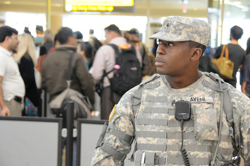 Staff Sergeant Keninde Ayeni assigned to Joint Task Force – Empire Shield alongside PAPD, DHS, TSA and other agencies provide security presence during a heightened security on the 9/11 anniversary on September 11, 2011 at JFK Airport, Queens, NY. JTF-ES provides a heavy visible military presence to deter terrorist threat and provide a show of force across New York City. With President Barack Obama, former President George W. Bush and many other dignitaries attending ceremonies citywide, multiple local, city, state and federal law enforcement agents has been deployed throughout New York City.<br /> <br /> (U.S. Air Force photo/Technical Sgt. Marcus P. Calliste/Released)