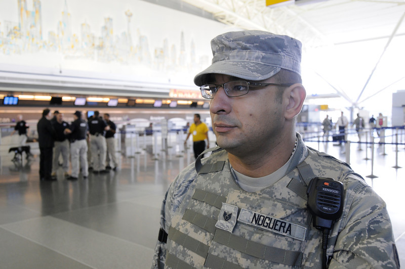 Staff Sergeant Johnny Noguera assigned to Joint Task Force – Empire Shield alongside PAPD, DHS, TSA and other agencies provide security presence during a heightened security on the 9/11 anniversary on September 11, 2011 at JFK Airport, Queens, NY. JTF-ES provides a heavy visible military presence to deter terrorist threat and provide a show of force across New York City. With President Barack Obama, former President George W. Bush and many other dignitaries attending ceremonies citywide, multiple local, city, state and federal law enforcement agents has been deployed throughout New York City.<br /> <br /> (U.S. Air Force photo/Technical Sgt. Marcus P. Calliste/Released)