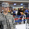 Specialist Michael Sloan assigned to Joint Task Force – Empire Shield alongside PAPD, DHS, TSA and other agencies provide security presence during a heightened security on the 9/11 anniversary on September 11, 2011 at JFK Airport, Queens, NY. JTF-ES provides a heavy visible military presence to deter terrorist threat and provide a show of force across New York City. With President Barack Obama, former President George W. Bush and many other dignitaries attending ceremonies citywide, multiple local, city, state and federal law enforcement agents has been deployed throughout New York City.<br /> <br /> (U.S. Air Force photo/Technical Sgt. Marcus P. Calliste/Released)