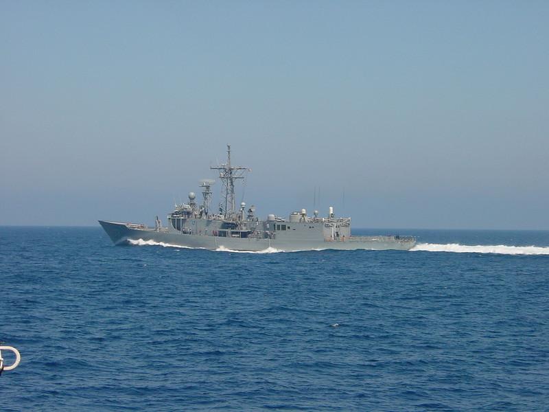 Frigate following alongside