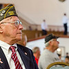 John Joseph listens to speakers during the Memorial Day service inside Leominster City Hall on Monday morning. SENTINEL & ENTERPRISE / Ashley Green