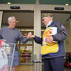 Members of the Leominster VFW Post 1807 were at Market Basket handing out Poppies to raise money for veterans in need on Friday. Tom Lazzara of Leominster donates and gets a poppy from John Joseph the head of the fundraiser.  SENTINEL & ENTERPRISE/JOHN LOVE