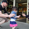 Members of the Leominster VFW Post 1807 were at Market Basket handing out Poppies to raise money for veterans in need on Friday. Leia Randall, 2, of Leominster donates and gets a poppy from John Joseph the head of the fundraiser. With Leia is her dad Dustin.  SENTINEL & ENTERPRISE/JOHN LOVE