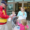 Members of the Leominster VFWPost 1807 were at Market Basket handing out Poppies to raise money for veterans in need. Jennifer Gifford and her kids Joshua, 9,  and Sarah, 5, of Shirley donate and get some poppies from Bob Bray after they finished shopping. SENTINEL & ENTERPRISE/JOHN LOVE