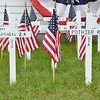 White crosses bearing the names of servicemen from Leominster who are missing-in-action, lost-at-sea, buried-at-sea or buried on foreign soil. A memorial service was held at the Leominster Veterans' Center on Friday evening. SENTINEL & ENTERPRISE / Ashley Green
