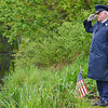 Larry McNeill, Chief MSgt. of the Air Force, salutes as he tosses flowers honoring soldiers who never returned home during the White Cross Memorial Service that was held at the Leominster Veterans' Center on Friday evening. SENTINEL & ENTERPRISE / Ashley Green
