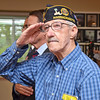 Joseph Kleczka, a veteran of the Army, salutes the flags during the White Cross Memorial Service that was held at the Leominster Veterans' Center on Friday evening. SENTINEL & ENTERPRISE / Ashley Green