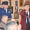Bob White, of Leominster, and Bill Campbell, of Clinton, both veterans of the Air Force, stand to be honored during the singing of the Air Force song at the White Cross Memorial Service that was held at the Leominster Veterans' Center on Friday evening. SENTINEL & ENTERPRISE / Ashley Green