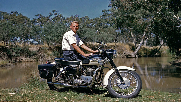 Note front mudguard name plate is away getting sign written. Goulburn River near Seymour. 'scuse me sitting side saddle on the bike, but I did'nt want to hide the great engine. This model was spoilt by the addition of a fool kind of auto clutch on the foot gearshift. My other T-110 up in Queensland had the normal hand clutch that any Weet Bix eater can handle easy. How come brake still requires hand ?