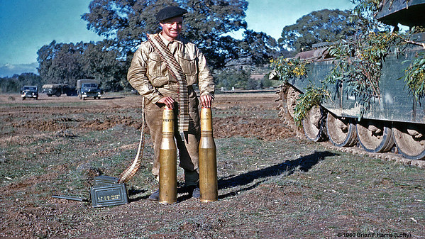 He was on the same tank gunnery course at Armoured School in Puckapunyal as author. Belt of ammo is for the Browning turrent mounted .30 cal machine gun. High explosive rounds for the Centurian tank 76mm main armament. Before firing, remove the snap on explosive protection on the nose. All ammo has tracer. Magic feeling for the gunner firing either type. Cordite aroma.