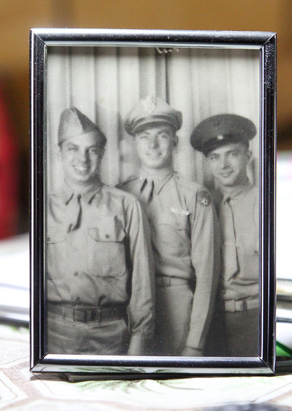 1943 family photo of WWII Army veteran Henry Naruszewicz, 103, of Lowell, who is going on an upcoming Honor Flight trip to Washington, DC.  From left, Henry, in Army uniform, younger brother Harry in the Army Air Corps, and older brother Edward, who was in the Marines. (SUN/Julia Malakie)