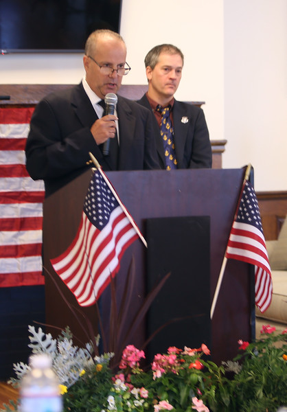 Ceremony at Rogers Hall and Edward T Gillis Square, commemorating the death in action in WWI of Private Gillis of Lowell. Gillis' great-nephew Joe Gillis of Westford, left, and Lowell & Dracut veterans agent Eric Lamarche, right.  (SUN/Julia Malakie)
