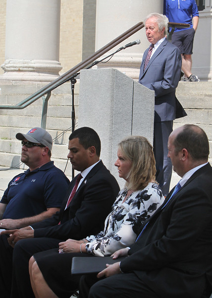 Lowell mayor Edward Kennedy, top, announces that the city has met the objectives of the Mayors Challenge to End Veterans Homelessness. Seated from left: Jason Gilbert of the Veterans Northeast Outreach Center, Massachusetts Secretary of Veterans Affairs Francisco Urena, HUD deputy regional administrator Kristine Foye, and associate director of the Edith Nourse Rogers Memorial Veterans Hospital Edward Koetting. (SUN/Julia Malakie)