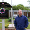 Barry Frechette of Billerica, at the Centralville Veterans Memorial, where Lowell's Memorial Day ceremonies will include Shigeaki Mori of Japan, who made sure the American POWs who died from the atomic bomb dropped on Hiroshima were remembered. Frechette's great uncle, Edward Chandonnet, was best friends growing up with Normand Brissette of Lowell, one of the POWs who survived the blast but died of radiation poisoning. (SUN/Julia Malakie)
