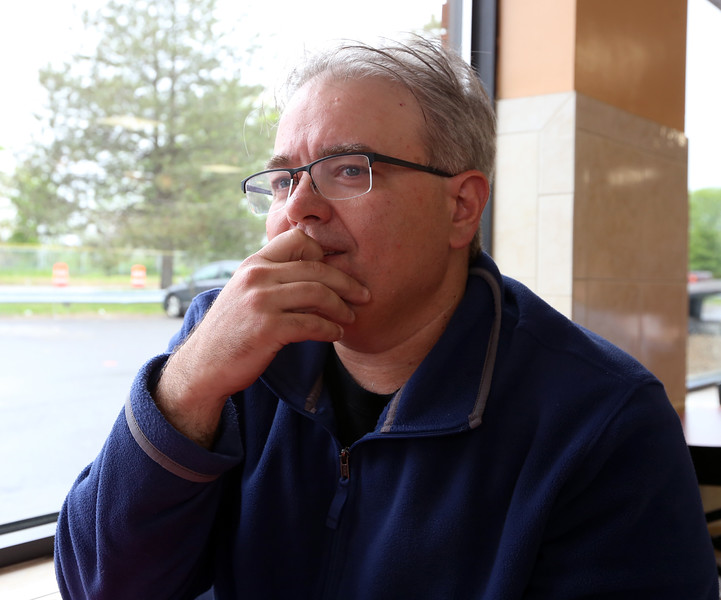 Barry Frechette of Billerica, at Top Donut, across from the Centralville Veterans Memorial, where Lowell's Memorial Day ceremonies will include Shigeaki Mori of Japan, who made sure the American POWs who died from the atomic bomb dropped on Hiroshima were remembered. Frechette's great uncle, Edward Chandonnet, was best friends growing up with Normand Brissette of Lowell, one of the POWs who survived the blast but died of radiation poisoning. (SUN/Julia Malakie)
