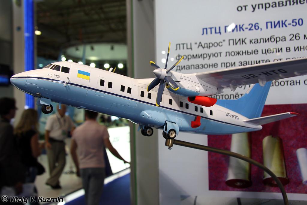 Ан-140 со станцией оптико-электронного подавления Адрос КТ-02 АСЭ и экранно-выхлопными устройствами (An-140 with Adros KT-02 ASE ECM system)