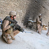 AL FALLUJAH, Iraq - Marines with 2d Platoon, E Company, 2d Battalion, 6th Marines pause in a house during a patrol of Al Fallujah, Iraq on August 28th, 2007. Second Platoon is based out of Observation Post Fenton and is tasked with patrolling the Dubat Precinct of Al Fallujah.