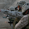 Master Sergeant Paul Bishop, with Combat Camera, II Marine Expeditionary Force (II MEF), conducts a pistol defensive drill on Camp Fallujah, Iraq on November 14, 2007. Camp Fallujah range helps Marines practice their shooting skills for qualification day, but more importantly readies them for combat. II MEF is deployed with Multi National Forces-West in support of Operation Iraqi Freedom in the Al Anbar province of Iraq to develop Iraqi Security Forces, facilitate the development of official rule of law through democratic reforms, and continue the development of a market based economy centered on Iraqi reconstruction. (Official USMC photograph by LCpl Caleb Gomez)
