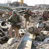Marines with 3rd Platoon, E Company, 2nd Battalion, 6th Marines, Regimental Combat Team 6, move through a scrap yard while on patrol in the Sina'a District of Al Fallujah, Iraq on September 16th, 2007. The Marines of 3rd Platoon are stationed at Observation Post Sina'a in the heart of Al Fallujah and are tasked with keeping it clear of Anti Coalition Forces.