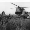 Marines leaving chopper on ground in B&W