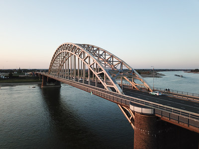 Soldiers of the U.S. 82nd Airborne Division successfully captured the Nijmegen bridge , which spans the Waal River flowing through the Netherlands.