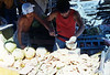 Carving coconuts in the marketplace in Olongapo City, R. P.. 16 Feb., 1987.
