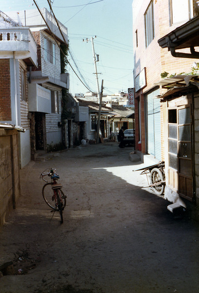 Osan, ROK. Oct. 6, 1985. Notice the dirt streets? <br /> <br /> Sidenote: I went back there in Sept. 2007 as a photographer for the USO and they paved this street finally!!