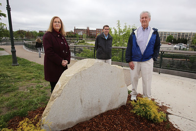 The intersection of Canal and Jackson Streets in the Hamilton Canal District will be dedicated to the late David McNerney, a Lowell native awarded the Congressional Medal of Honor resulting from his service during the Vietnam war. Standing by the yet-to-be-engraved stone, from right, are McNerney's cousin Joseph Smith of Lowell, Smith's nephew (and McNerney's cousin once removed)  Dick Howe, Jr., and McNerney's niece Ann Turner of Chelmsford. (SUN/Julia Malakie)