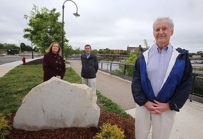The intersection of Canal and Jackson Streets in the Hamilton Canal District will be dedicated to the late David McNerney, a Lowell native awarded the Congressional Medal of Honor resulting from his service during the Vietnam war. Standing by the yet-to-be-engraved stone are McNerney's cousin Joseph Smith of Lowell, right, Smith's nephew (and McNerney's cousin once removed)  Dick Howe, Jr., and McNerney's niece Ann Turner of Chelmsford. (SUN/Julia Malakie)