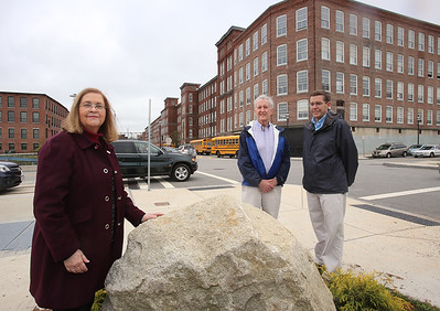 The intersection of Canal and Jackson Streets in the Hamilton Canal District will be dedicated to the late David McNerney, a Lowell native awarded the Congressional Medal of Honor resulting from his service during the Vietnam war. Standing by the yet-to-be-engraved stone are McNerney's cousin Joseph Smith of Lowell, center, Smith's nephew (and McNerney's cousin once removed)  Dick Howe, Jr., and McNerney's niece Ann Turner of Chelmsford. (SUN/Julia Malakie)