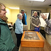 From left, Eileen Barnacoat of Townsend, Beverly Lemieux of Leominster, and Walter and wife Diane Romanosky of Westford, talk with Tom Sommer of West Groton after his talk at the Fort Devens Museum about his November 2019 trip to the Meuse Argonne region of France for the centennial of the end of WWI. (SUN/Julia Malakie)
