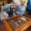 Talk at the Fort Devens Museum about his November 2019 trip to the Meuse Argonne region of France for the centennial of the end of WWI. Christine Lattanzi of Lunenberg, left, Beverly Lemieux of Leominster, look at artifacts that speaker Tom Sommer found on the trip.  (SUN/Julia Malakie)