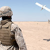 US Marine Corps (USMC) Lance Corporal (LCPL) David Fierro, 2nd Military Police (MP) Battalion (BN), Bravo Company (B CO), 5th Platoon (PLT), launches the Dragon Eye Unmanned Aerial Vehicle (UAV) along the MSR (main supply road) Lyman Road.  The Dragon Eye is a small plane guided by computers and provides real time video of the terrain below it.  The Marines use the Dragon Eye during their patrol to find any IED's (Improvised Explosive Device) or suspicious people traveling on the roads.