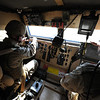 U.S. Navy Lt. j.g. Thomas House, left, assigned to Commander, Task Force 56, receives instructions from Petty Officer 1st Class Bernard McPeak, assigned to Commander, Task Group 56.2/25 Naval Construction Regiment Forward, while driving a mine-resistant, ambush-protected vehicle Nov. 14, 2010, in Kuwait City, Kuwait. CTF 56 is a multinational task force established in January 2009 to support maritime security operations and theater security cooperation efforts in the U.S. 5th Fleet area of responsibility. (U.S. Navy photo by Mass Communication Specialist 1st Class Michael O'Day/Released)